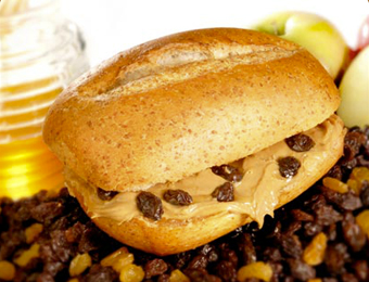 Peanut Butter and Raisins on a Wheat Club Roll